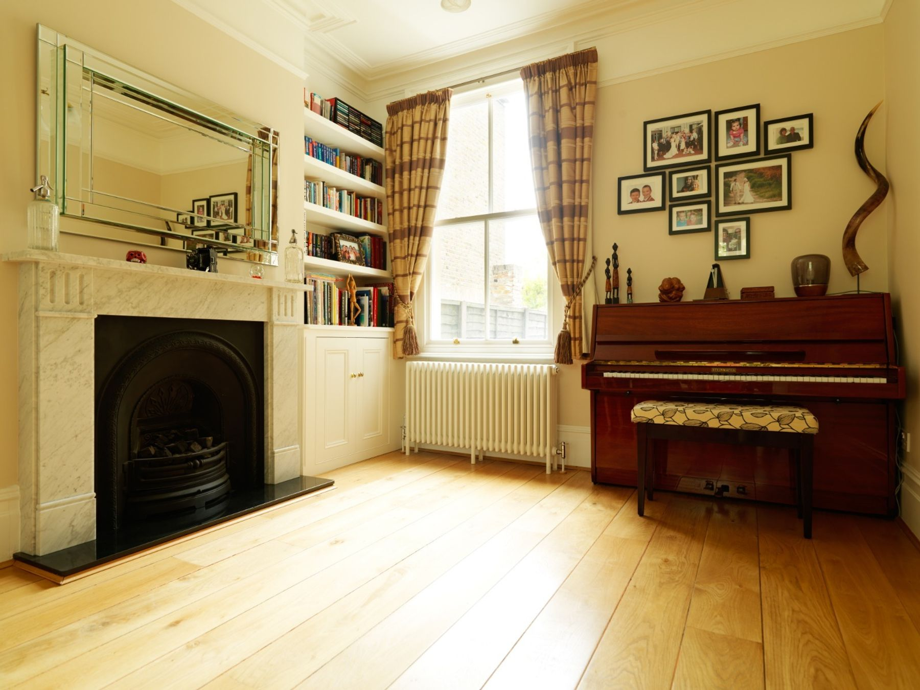 Living Room/Dining Room rehearsal space with upright piano