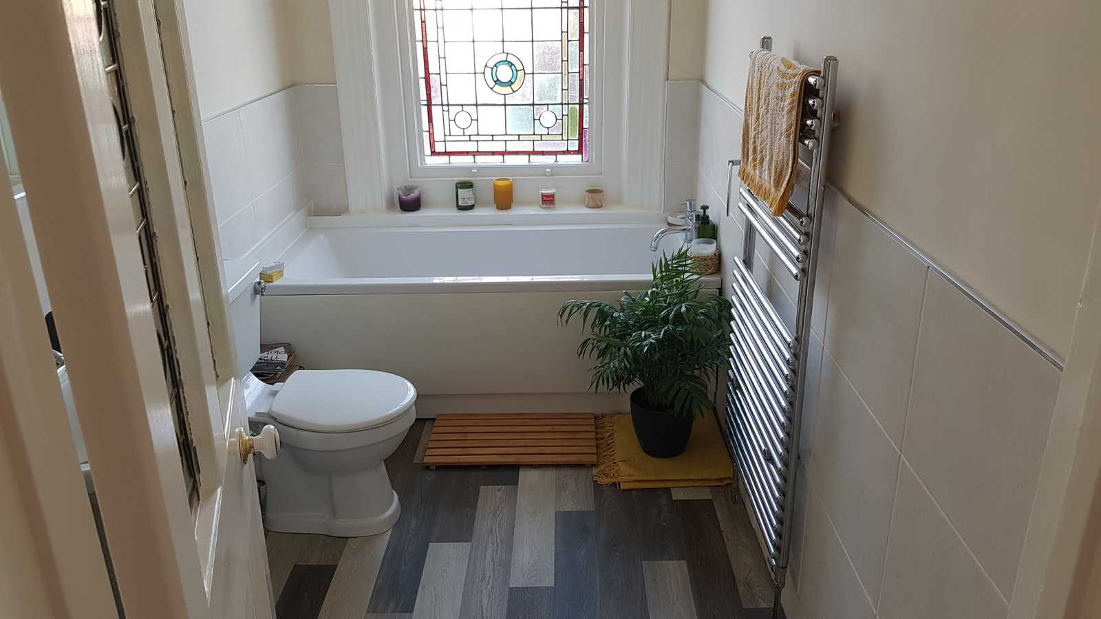 Bathroom with stained glass window