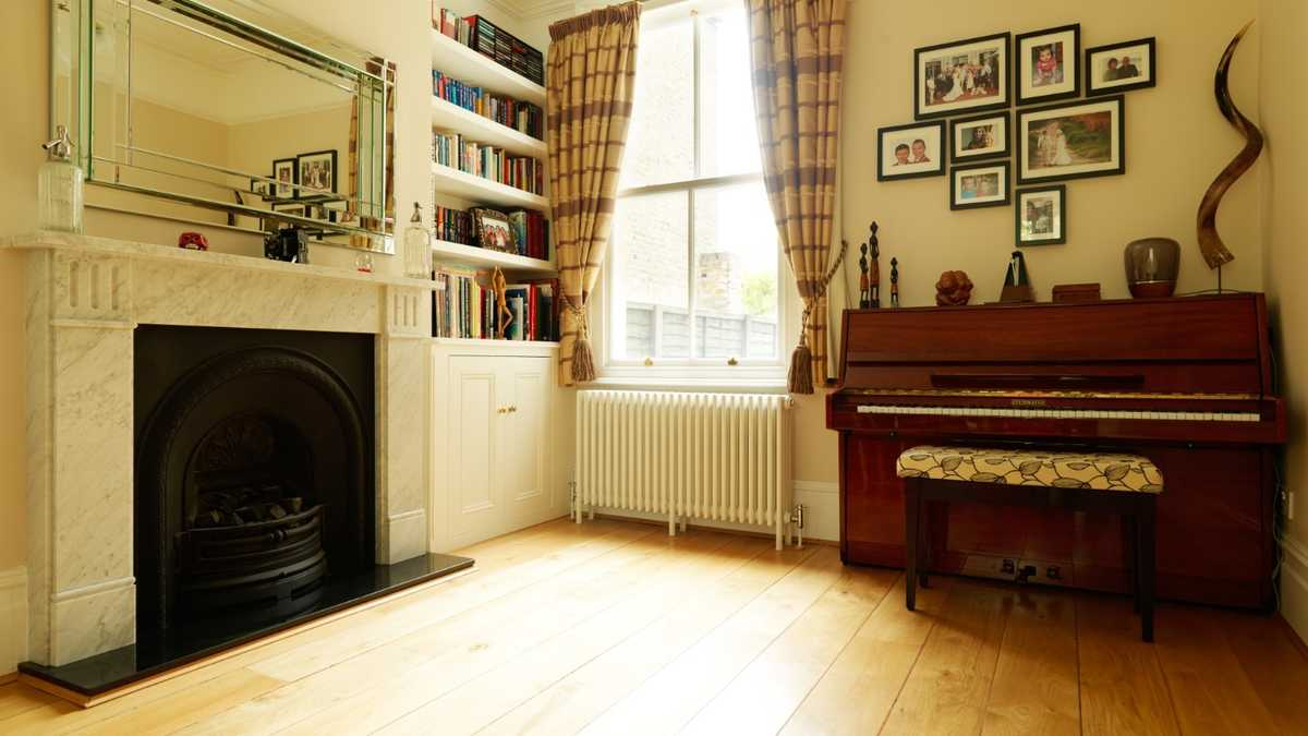 Living Room rehearsal space with upright piano