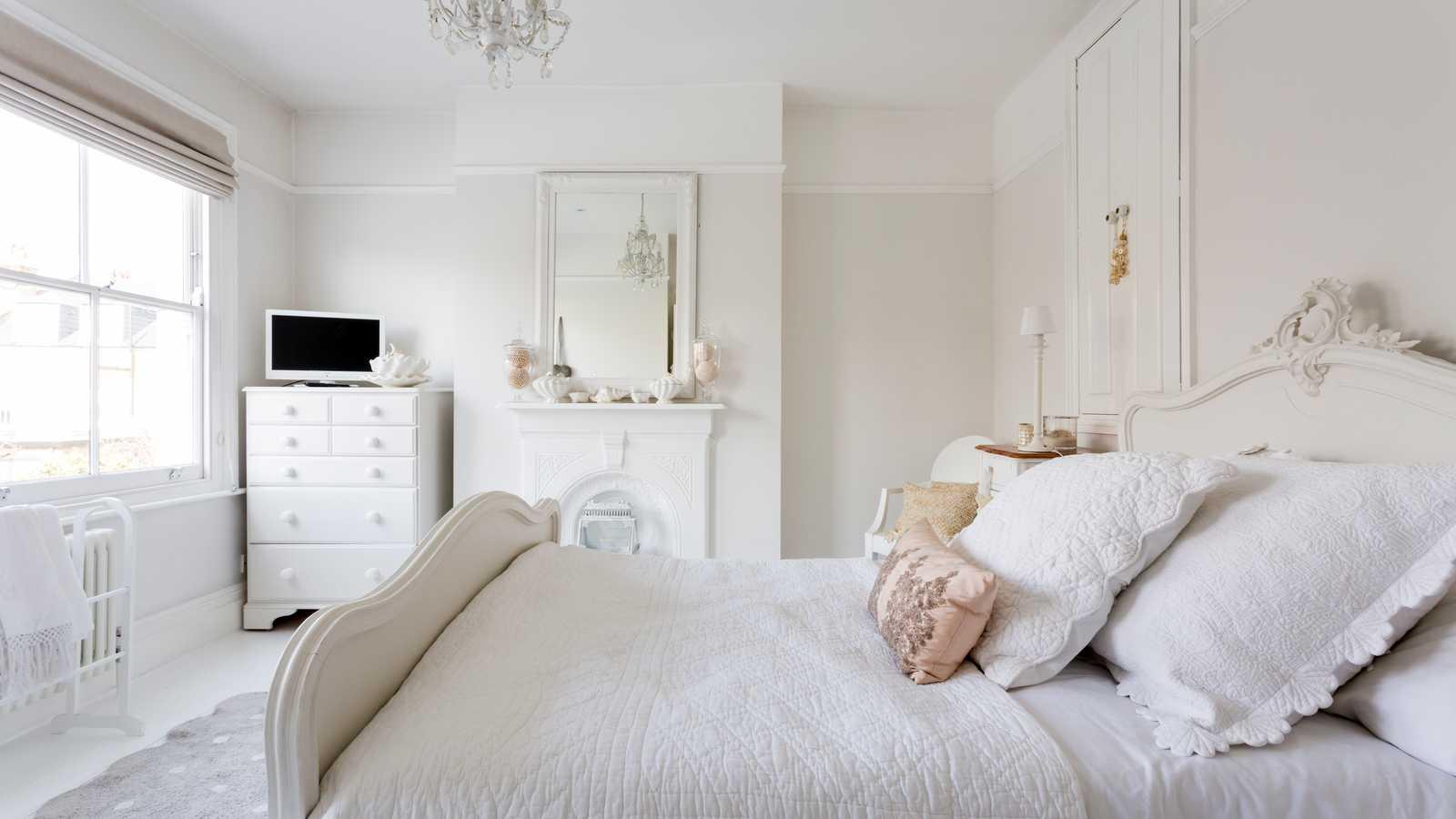 White floorboard bedroom